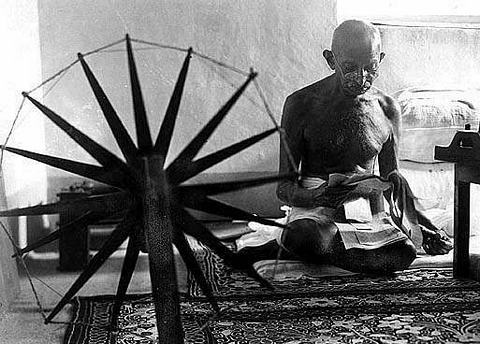 Mahatma Gandhi at the Charaka or Spinning Wheel
