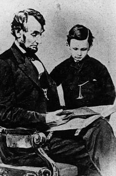 Abraham Lincoln and son reading a book